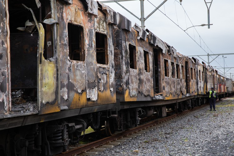 Photo of burnt out train coaches