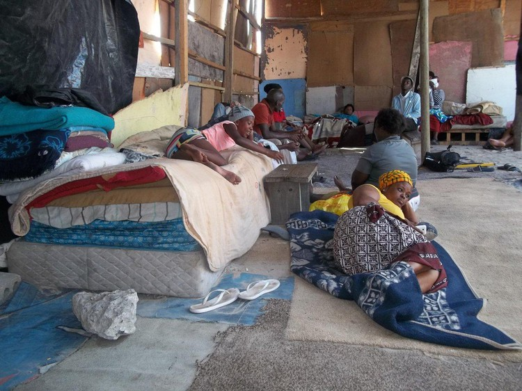 Photo of people living in large shack