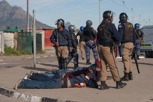 Photo of arrest during Langa protest