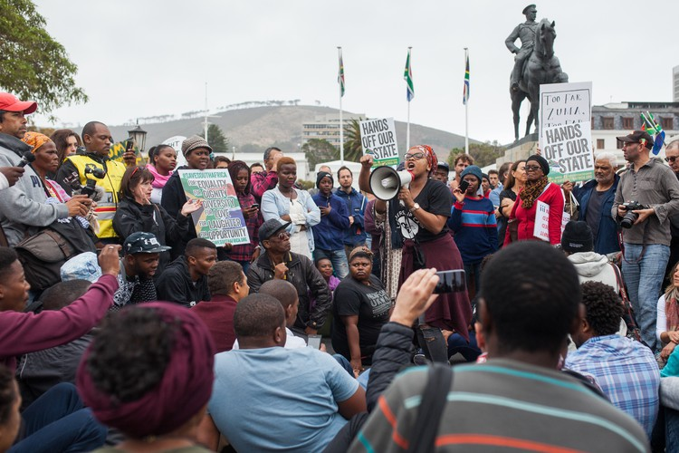 Phumeza Mlungwana, General Secretory of the Social Justice Coalition (SJC)  addresses the crowd outside Parliament during a Protest against president Jacob Zuma. The protest came after the firing of Finance Minister Pravin Gordhan and the reshuffling of the cabinet.
