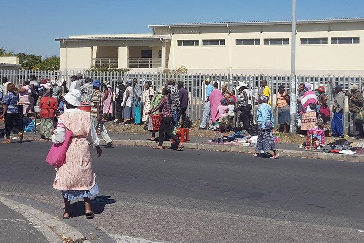Photo of people queuing for social grants