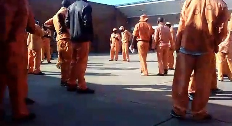 Photo of prisoners in a courtyard