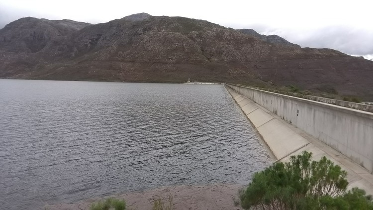 The dam is full and water is being released through a sluice gate. Photo: Faizel Slamang