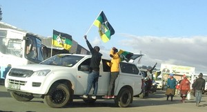 Photo of car with people campaigning for the ANC