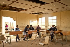 Photo of school children in dilapidated classroom