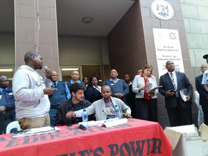 Photo of Equal Education handing over social audit at Western Cape government offices