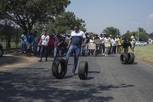 Photo of protesters, some with tyres