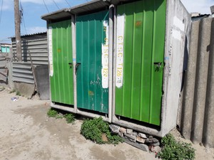 Photo of toilet with green door