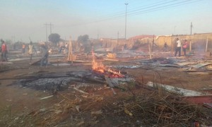 Photo of cleared shacks