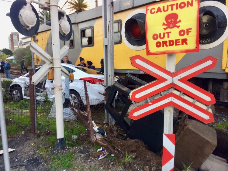 Photo of a train and a smashed car