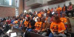 Photo of Black Sash members in orange t-shirts at Constitutional Court