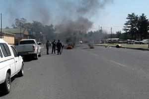 Photo of burning tyres in road