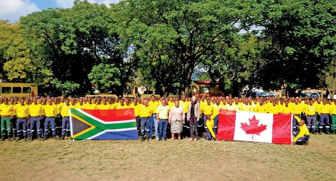 Photo of firefighters with South African and Canadian flags