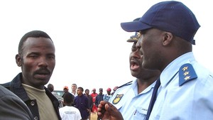 Photo of Sikhosiphi Bazooka Rhadebe and police