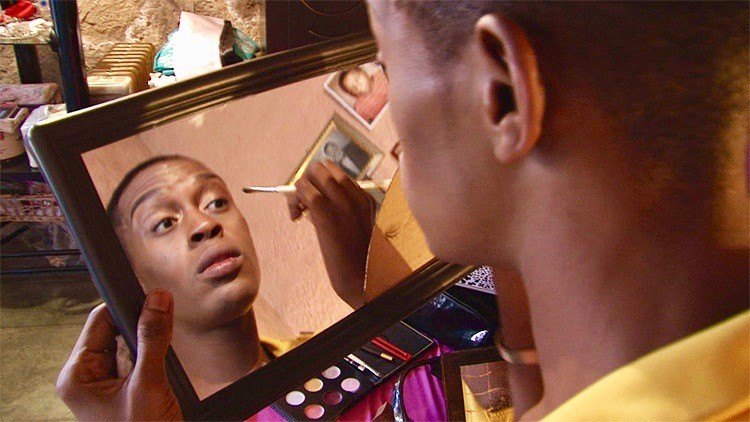 Photo of a person putting on make-up