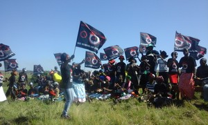 Photo of protesters with flags saying No mining on our land