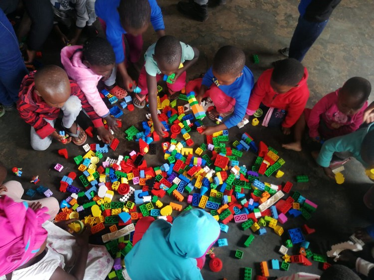 Children play with Lego at a creche at Tholokuhle – one of several local educational initiatives Tendele Mining has sponsored.