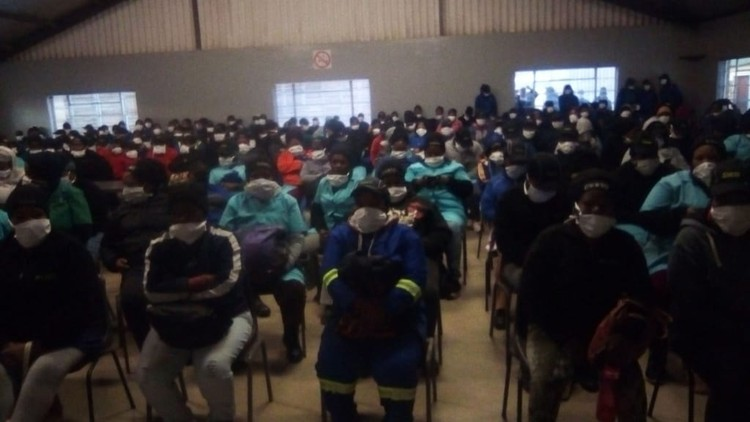 Photo of Nduli residents sitting in the hall