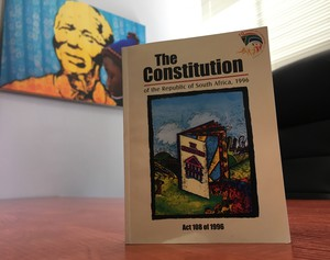 Photo of Constitution against background of Mandela wallart