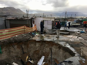 Photo of a big hole and shacks