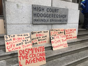 Photo of placards at court