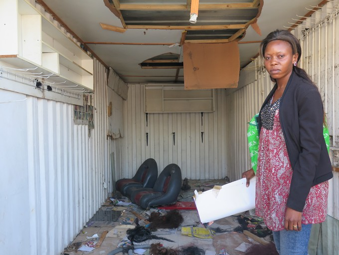 Photo of woman inside looted shop