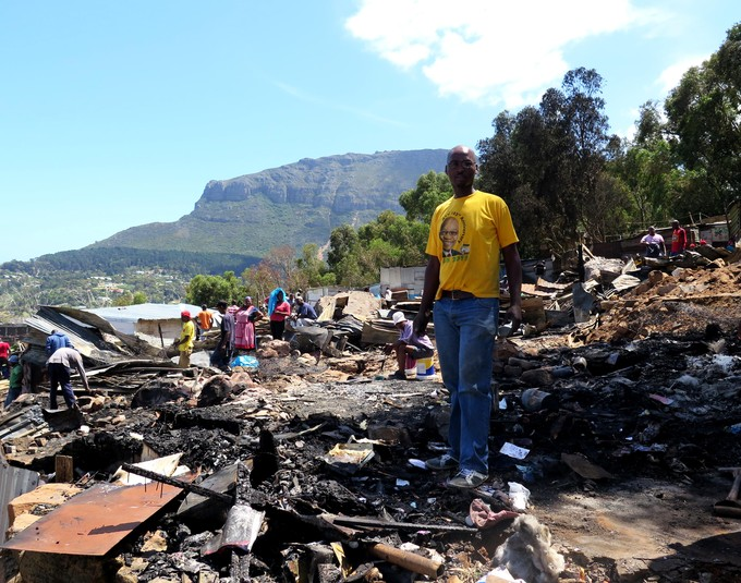 Photo of a man in Imizamo Yethu after the fire.