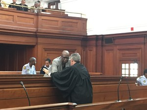 Photo of two men in a court room