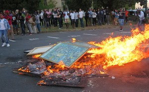 Photo of artwork being burnt on UCT.
