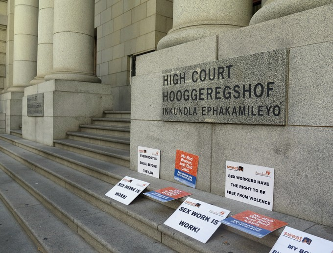 Photo of placards outside the Western Cape High Court