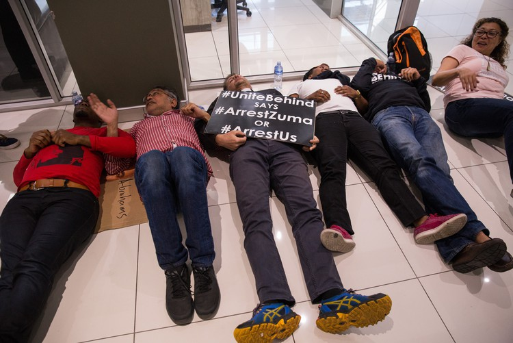 Photo of several people lying on the floor