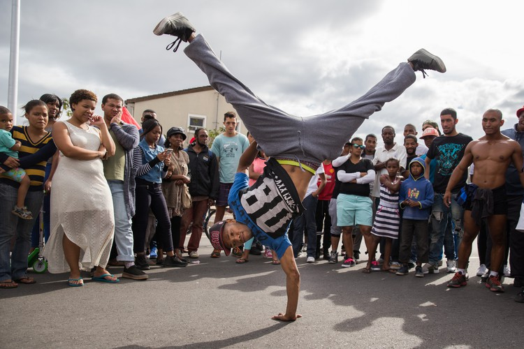 Photo of man breakdancing