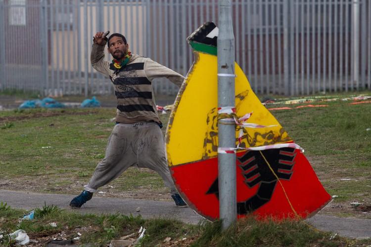 Photo of man throwing stone