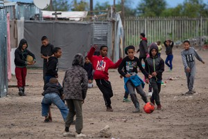 Photo of children playing soccer