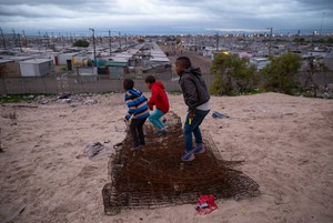 Photo of children playing on a hill just outside Blikkiesdorp, a temporary relocation area (TRA) found about 25km's from Cape Town's city centre
