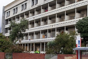 Residents occupy the old Helen Bowden Nurses Home near the V&A Waterfront in Cape Town.