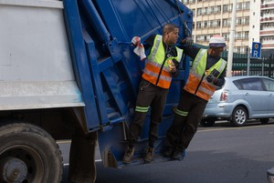 Photo of two people on garbage truck
