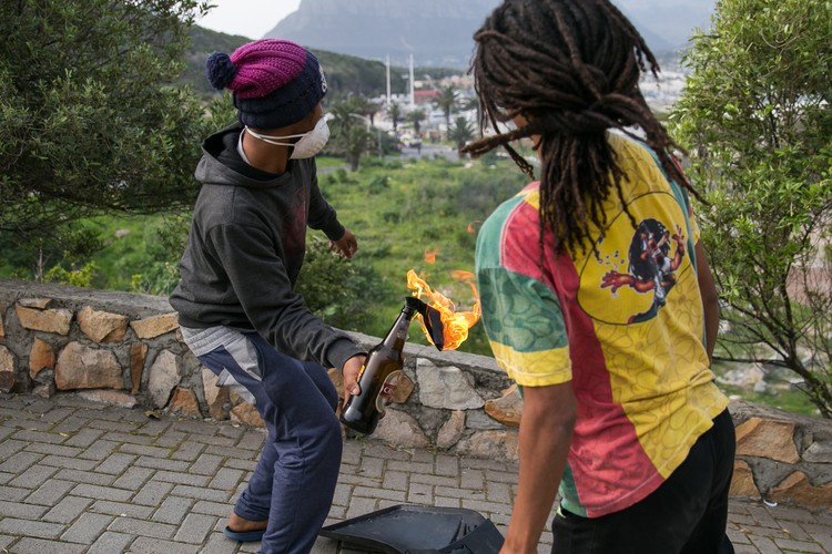 Photo of Hangberg resident throwing petrol bomb