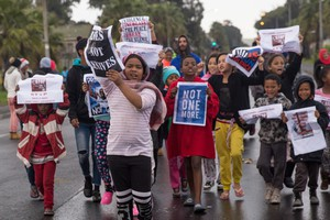 About 100 hundreds residents in Hanover Park block streets protesting against gang violence.
