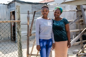 Lerato Ruth Sihlangu and her Auntie, Noncedo Mlilwana outside their home in Mfuleni. Sihlangu matriculated amongst the top of her year at Masiyile High School in Khayelitsha. Photo: Ashraf Hendricks
