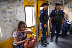 Photo of officers on a train