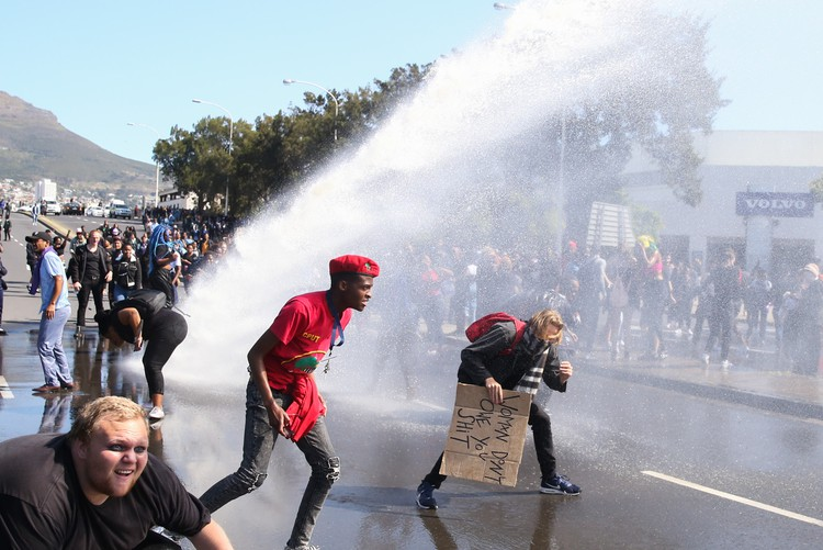 Photo of water cannon spraying people