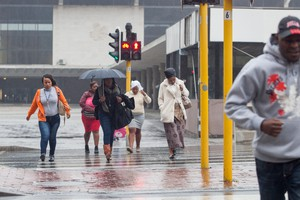 Photo of people walking in rain