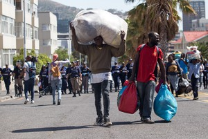 Photo of refugee carrying his belongings