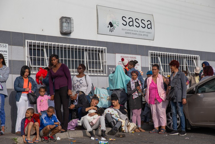 Photo of people outside a SASSA office