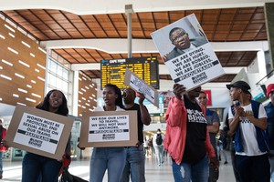 Photo of picketers at the train station