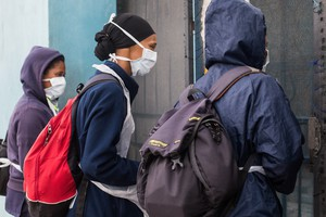Photo of people wearing masks