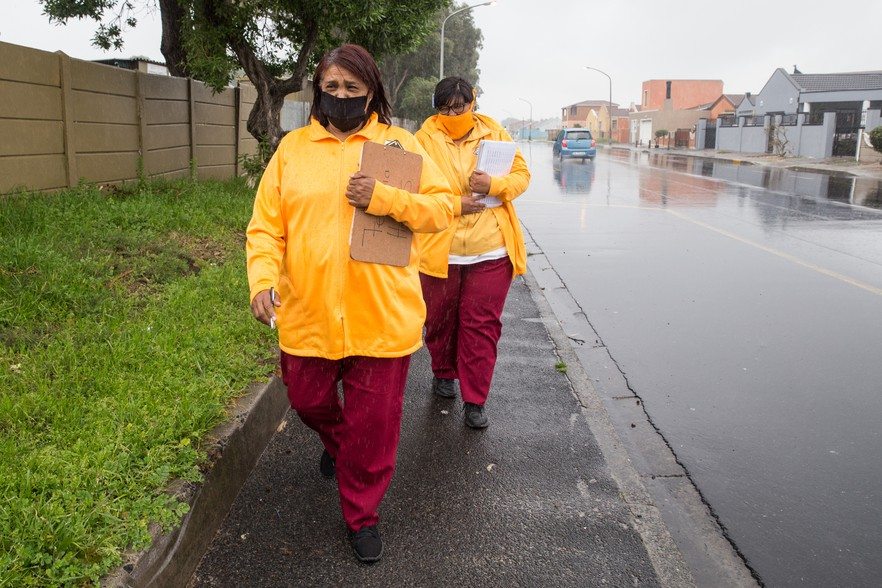 Whether it's rain or shine, field workers Felicia Davids and Raylene Kotze deliver chronic medicines in the Westridge area. On this particular day, they did 32 deliveries.