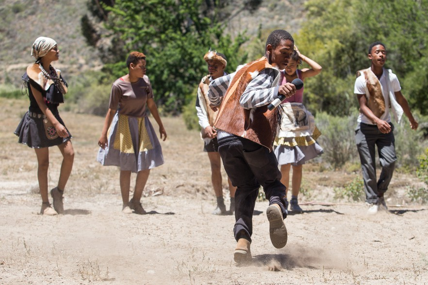 Performers do a traditional reed dance during the filming of Booi's Soul Searching Adventures. Inspired by the 2014 production Kagg'agn Dreams the story follows a young boy and his rediscovery of his roots within Hessequa heritage.