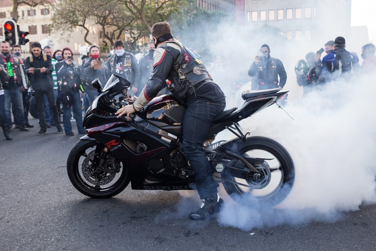"A biker ""burns rubber"" during the farm murder protest in south africa"
